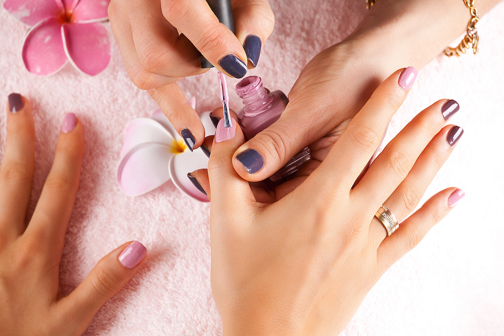Bright stylish manicure with colored nail. Manicure process close up.