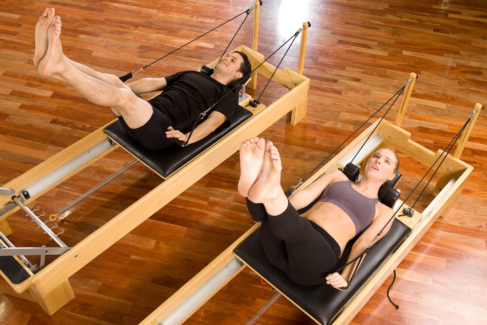 Man and woman at a Pilates class at the day spa health retreat