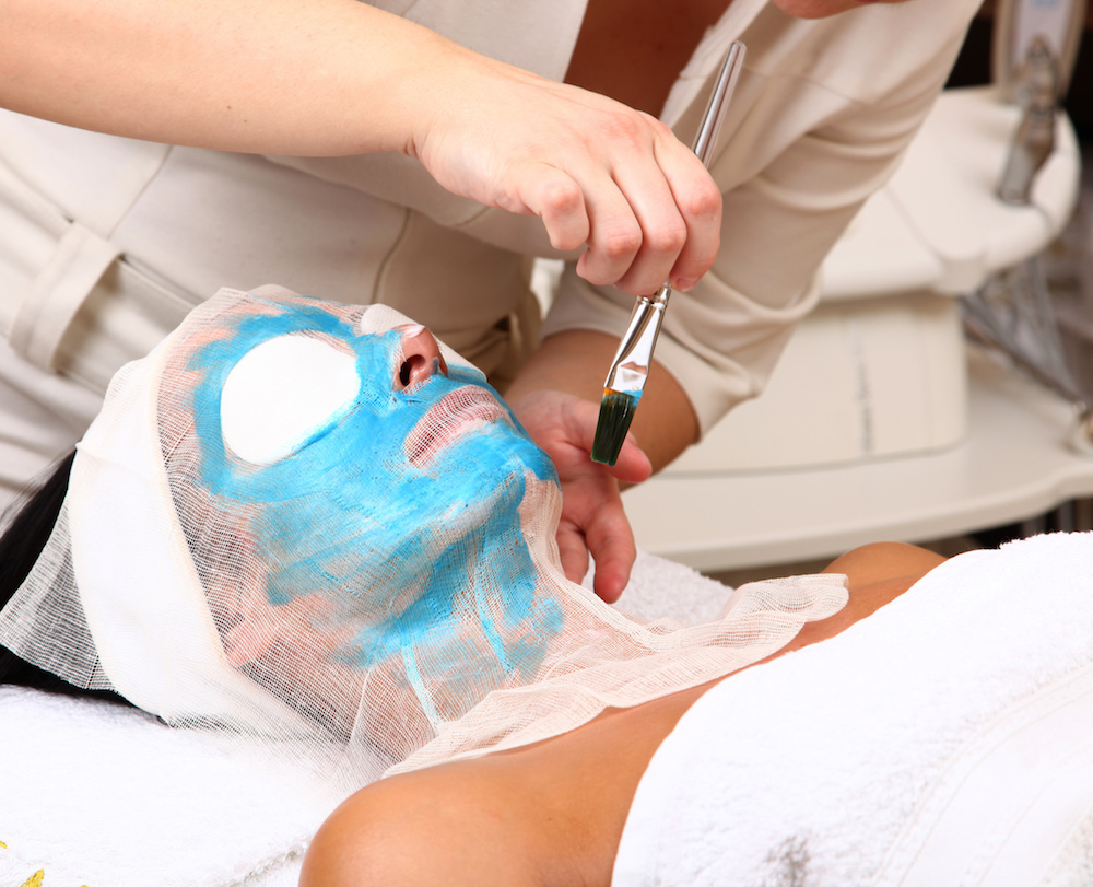 Woman getting a beauty mask at the spa