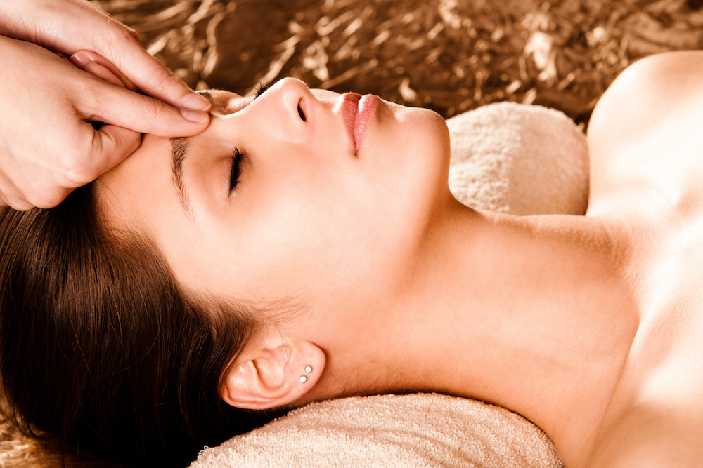 Woman receiving accupressure from registered massage therapist at the spa